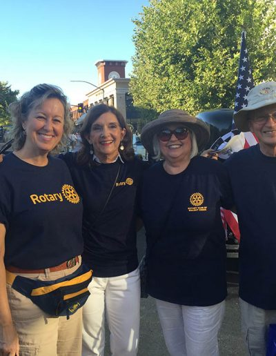 Rotarians Walking in Twilight Parade